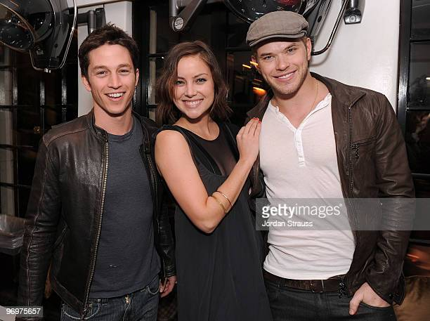 Actors Bobby Campo Jessica Stroup and Kellan Lutz pose at the Nine Zero One Salon Grand Opening and Book Party at Nine Zero One Salon on February 22...