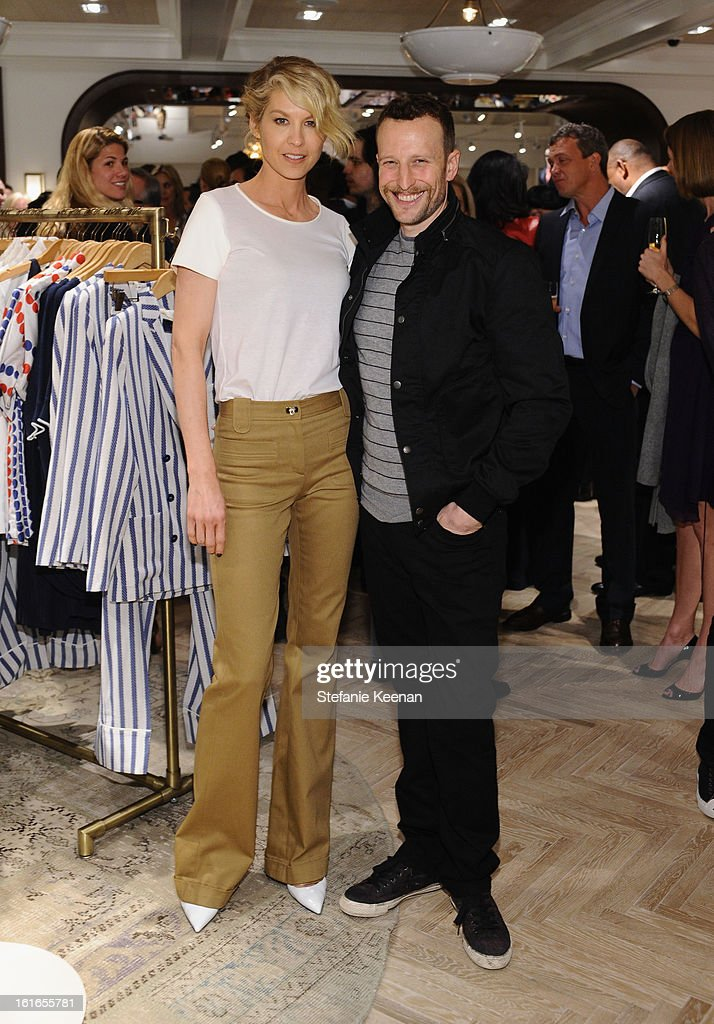 Actors Bodhi Elfman (R) and Jenna Elfman attend Tommy Hilfiger New West Coast Flagship Opening on Robertson Boulevard on February 13, 2013 in West Hollywood, California.