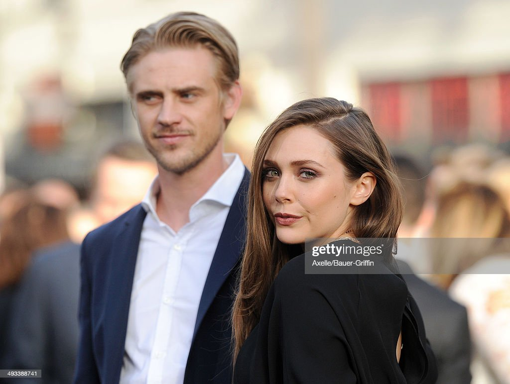 Actors <a gi-track='captionPersonalityLinkClicked' href=/galleries/search?phrase=Boyd+Holbrook&family=editorial&specificpeople=4436993 ng-click='$event.stopPropagation()'>Boyd Holbrook</a> (L) and <a gi-track='captionPersonalityLinkClicked' href=/galleries/search?phrase=Elizabeth+Olsen&family=editorial&specificpeople=5775031 ng-click='$event.stopPropagation()'>Elizabeth Olsen</a> arrive at the Los Angeles premiere of 'Godzilla' at Dolby Theatre on May 8, 2014 in Hollywood, California.