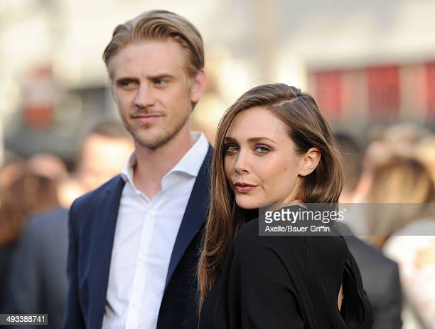 Actors Boyd Holbrook and Elizabeth Olsen arrive at the Los Angeles premiere of 'Godzilla' at Dolby Theatre on May 8 2014 in Hollywood California