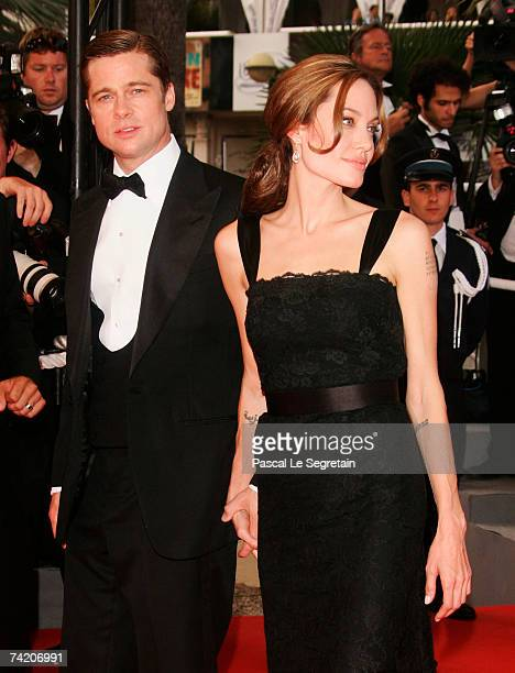 Actors Brad Pitt and Angelina Jolie attend the premiere for the film 'A Mighty Heart' at the Palais des Festivals during the 60th International...