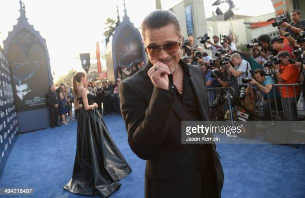Actors Brad Pitt and Angelina Jolie attend the World Premiere of Disney's 'Maleficent' starring Angelina Jolie at the El Capitan Theatre on May 28...