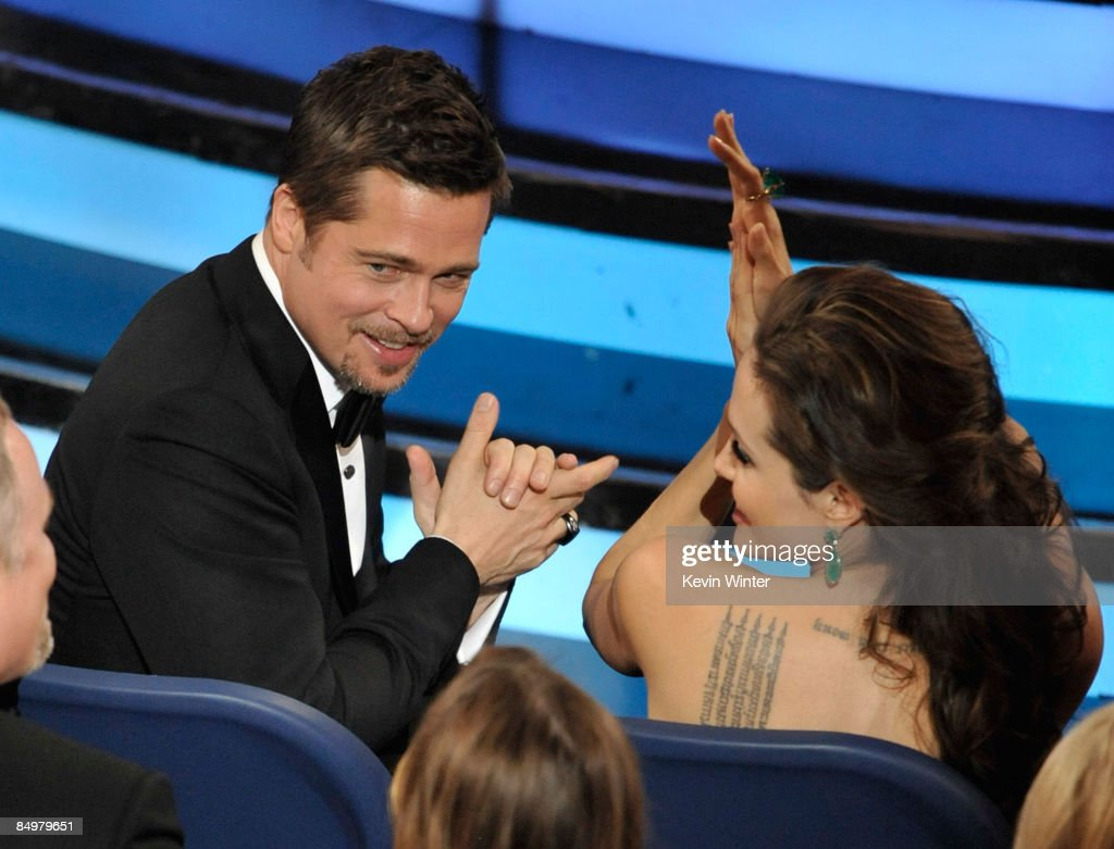 Actors <a gi-track='captionPersonalityLinkClicked' href=/galleries/search?phrase=Brad+Pitt+-+Actor&family=editorial&specificpeople=201682 ng-click='$event.stopPropagation()'>Brad Pitt</a> and <a gi-track='captionPersonalityLinkClicked' href=/galleries/search?phrase=Angelina+Jolie&family=editorial&specificpeople=201591 ng-click='$event.stopPropagation()'>Angelina Jolie</a> clap during the 81st Annual Academy Awards held at Kodak Theatre on February 22, 2009 in Los Angeles, California.