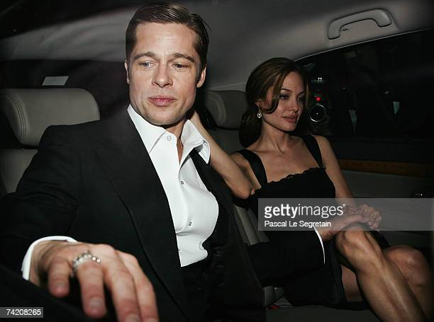 Actors Brad Pitt and Angelina Jolie depart the premiere for the film 'A Mighty Heart' at the Palais des Festivals during the 60th International...