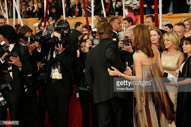 Actors Brad Pitt and Angelina Jolie face the cameras as they arrive at the 14th annual Screen Actors Guild awards held at the Shrine Auditorium on...