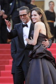 US actors Brad Pitt and Angelina Jolie pose on the red carpet before the screening of 'The Tree of Life' presented in competition at the 64th Cannes...