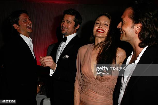 Actors Brad Pitt and Angelina Jolie talk with Manuele Malenotti and Michele Malenotti vice presidents of Belstaff during the ''Inglourious Basterds'...