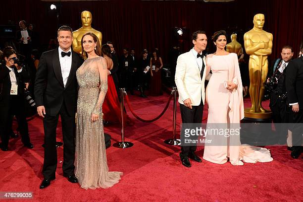 Actors Brad Pitt Angelina Jolie Matthew McConaughey and Camila Alves attend the Oscars held at Hollywood Highland Center on March 2 2014 in Hollywood...