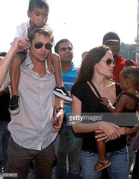 US actors Brad Pitt with son Maddox and Angelina Jolie with daughter Zahara take a stroll on the seafront promenade in Mumbai 12 November 2006 Jolie...