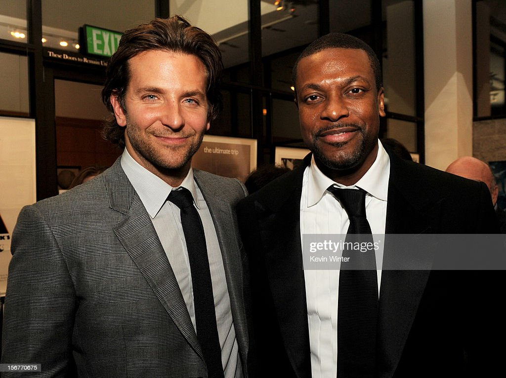 Actors Bradley Cooper (L) and Chris Tucker pose at the after party for a screening of The Weinstein Company's 'Silver Lining's Playbook' at the Academy of Motion Picture Arts and Sciences on November 19, 2012 in Beverly Hills, California.