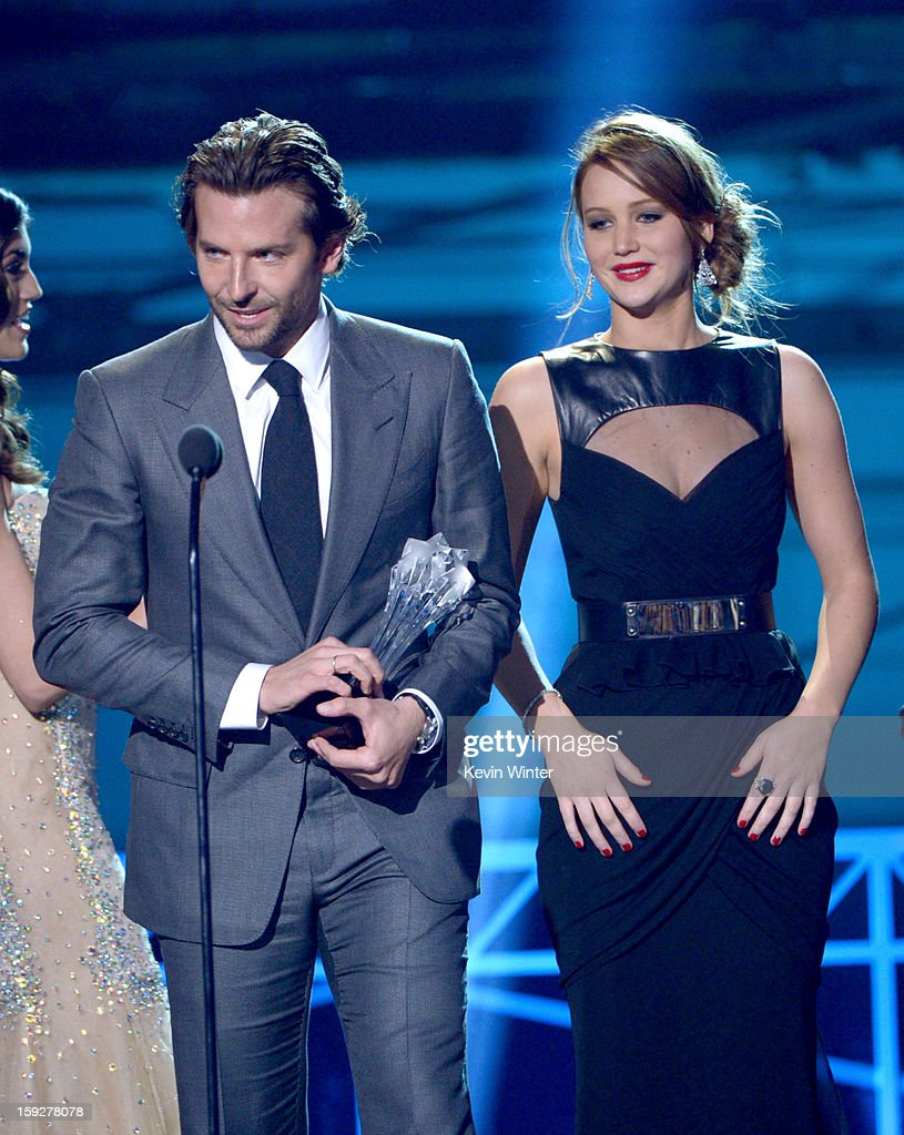 Actors Bradley Cooper (L) and Jennifer Lawrence accept the Best Acting Ensemble Award for 'Silver Linings Playbook' onstage at the 18th Annual Critics' Choice Movie Awards held at Barker Hangar on January 10, 2013 in Santa Monica, California.