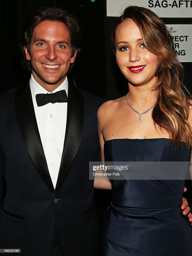 Actors <a gi-track='captionPersonalityLinkClicked' href=/galleries/search?phrase=Bradley+Cooper&family=editorial&specificpeople=680224 ng-click='$event.stopPropagation()'>Bradley Cooper</a> (L) and <a gi-track='captionPersonalityLinkClicked' href=/galleries/search?phrase=Jennifer+Lawrence&family=editorial&specificpeople=1596040 ng-click='$event.stopPropagation()'>Jennifer Lawrence</a> attend the 19th Annual Screen Actors Guild Awards at The Shrine Auditorium on January 27, 2013 in Los Angeles, California. (Photo by Christopher Polk/WireImage) 23116_012_0897A.jpg