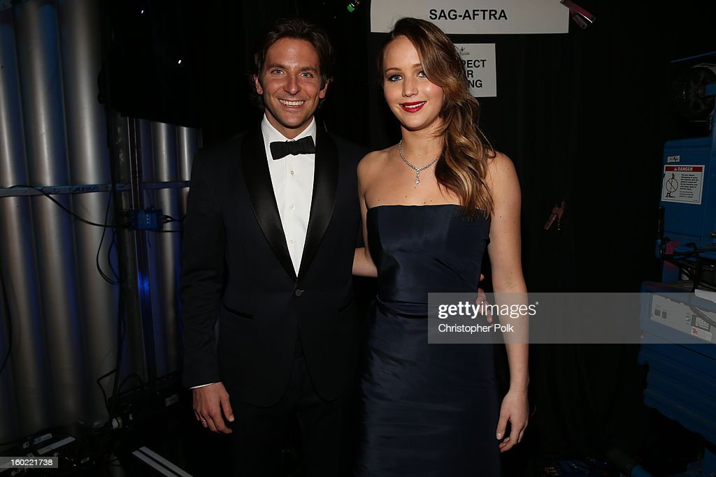 Actors <a gi-track='captionPersonalityLinkClicked' href=/galleries/search?phrase=Bradley+Cooper&family=editorial&specificpeople=680224 ng-click='$event.stopPropagation()'>Bradley Cooper</a> (L) and <a gi-track='captionPersonalityLinkClicked' href=/galleries/search?phrase=Jennifer+Lawrence&family=editorial&specificpeople=1596040 ng-click='$event.stopPropagation()'>Jennifer Lawrence</a> attend the 19th Annual Screen Actors Guild Awards at The Shrine Auditorium on January 27, 2013 in Los Angeles, California. (Photo by Christopher Polk/WireImage) 23116_012_0897.JPG