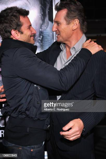 Actors Bradley Cooper and Liam Neeson arrive to the premiere of Open Road Films' 'The Grey' on January 11 2012 in Los Angeles California