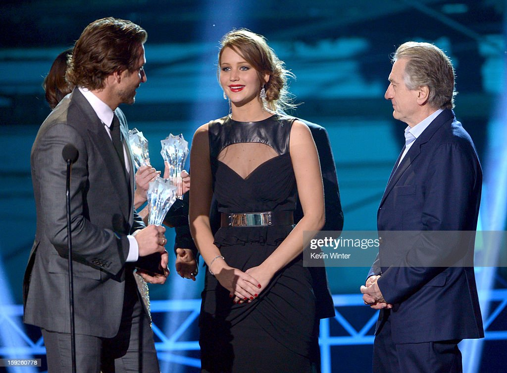 Actors Bradley Cooper, Jennifer Lawrence and Robert De Niro accept the Best Acting Ensemble Award for 'Silver Linings Playbook' onstage at the 18th Annual Critics' Choice Movie Awards held at Barker Hangar on January 10, 2013 in Santa Monica, California.