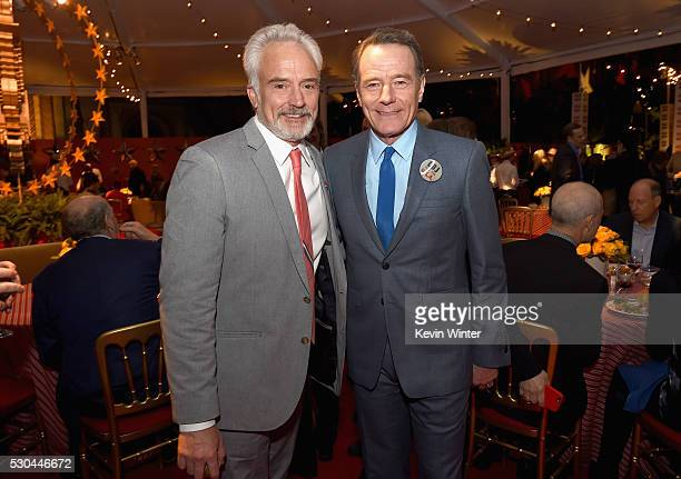 Actors Bradley Whitford left and Bryan Cranston attend the afterparty of the Premiere Of HBO's 'All The Way' on May 10 2016 in Hollywood California