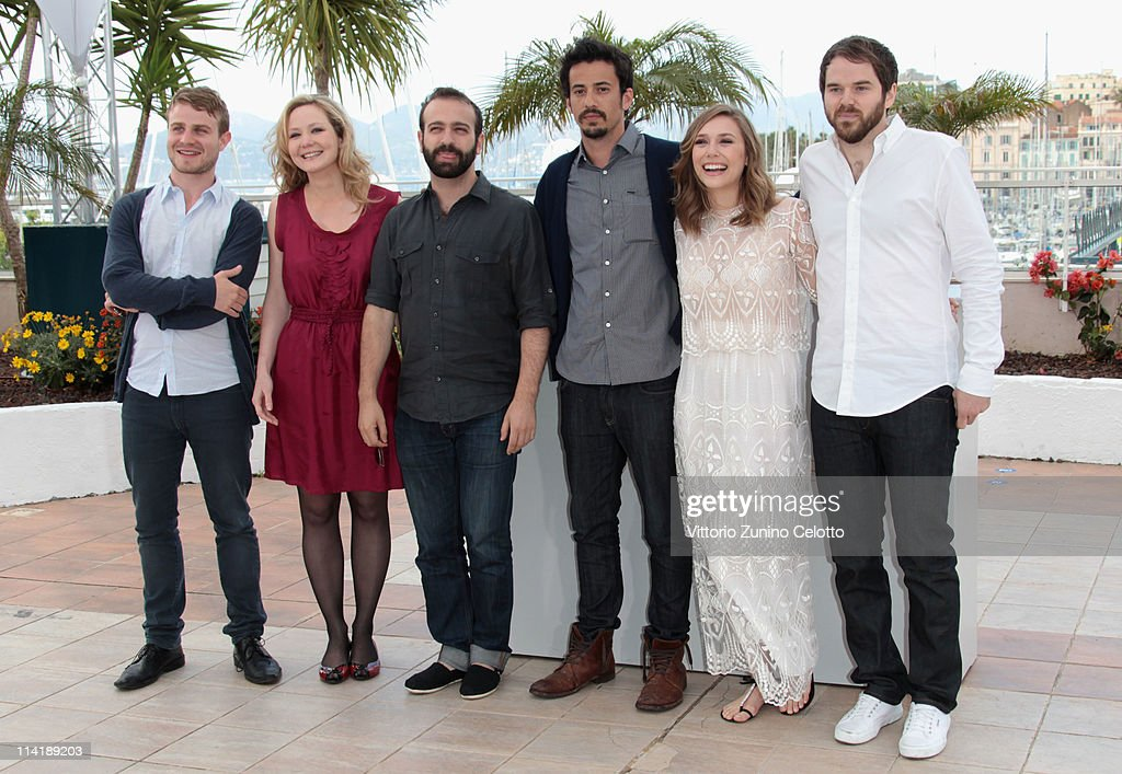 Actors Brady Corbet, Louisa Krause, producer Antonio Campos, producer Josh Mond, Elizabeth Olsen and director Sean Durkin attend the 'Martha Marcy May Marlene' photocall at the Palais des Festivals during 64th Cannes Film Festival on May 15, 2011 in Cannes, France.