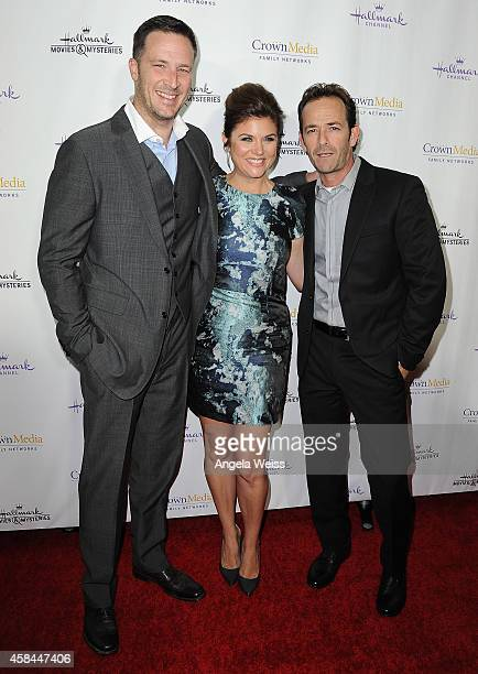 Actors Brady Smith Tiffani Thiessen and Luke Perry arrive at Hallmark Channel's annual holiday event premiere screening of 'Northpole' at La Piazza...