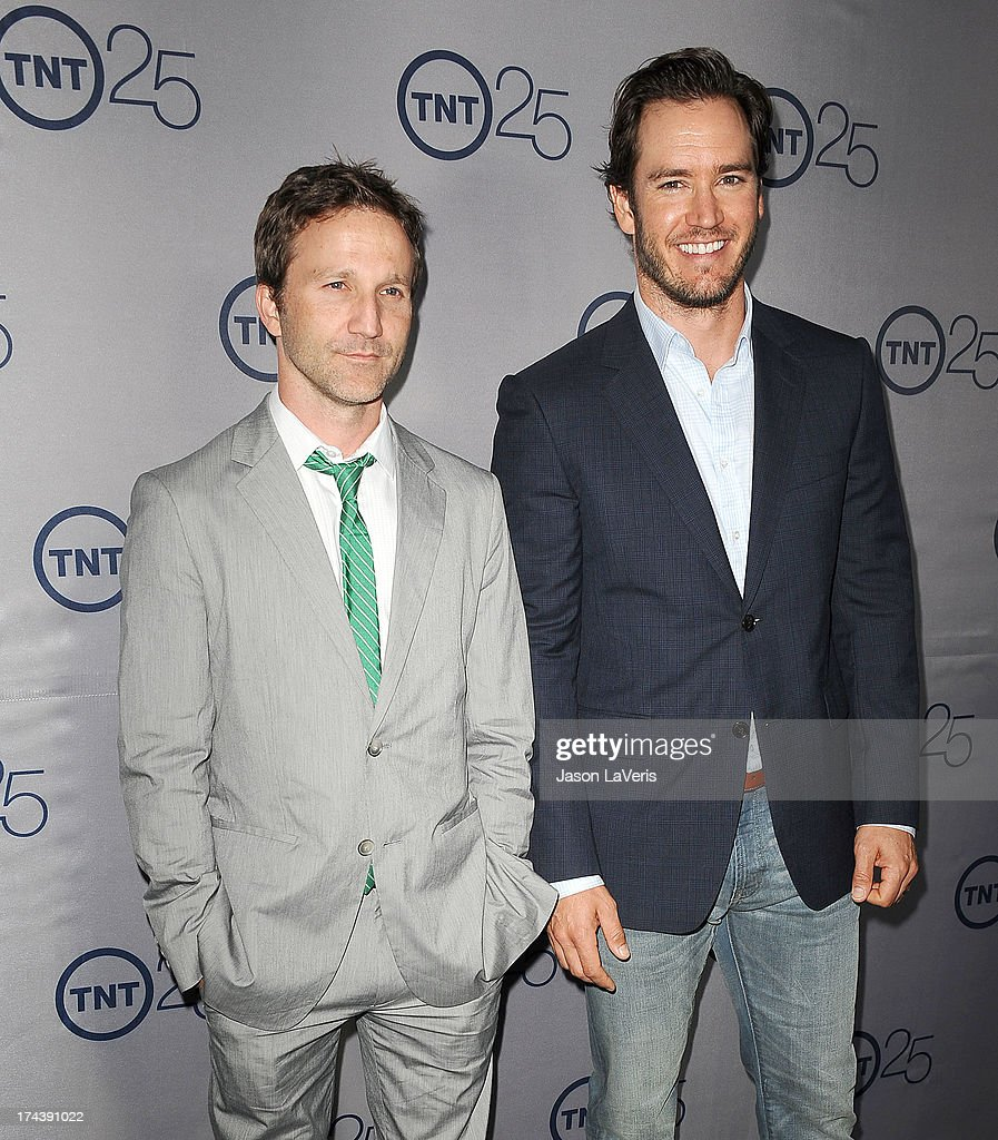 Actors Breckin Meyer and Mark-Paul Gosselaar attend TNT's 25th anniversary party at The Beverly Hilton Hotel on July 24, 2013 in Beverly Hills, California.