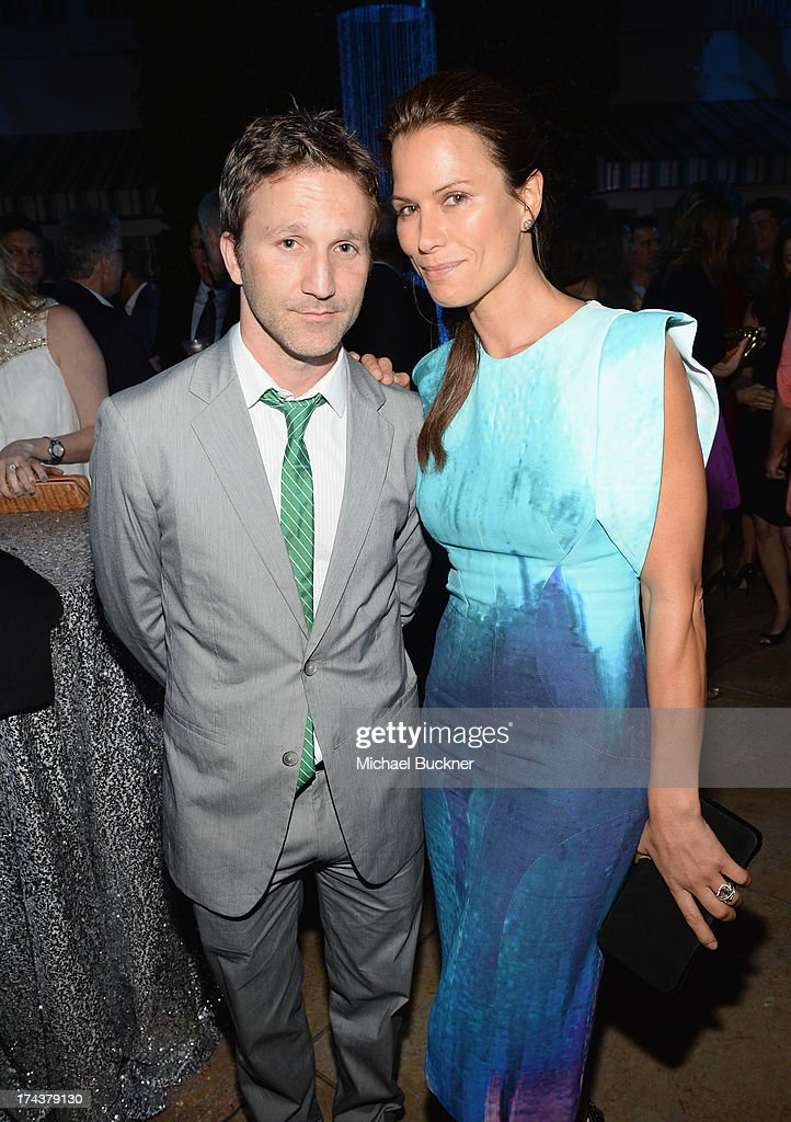 Actors Breckin Meyer and Rhona Mitra attend TNT 25TH Anniversary Party during Turner Broadcasting's 2013 TCA Summer Tour at The Beverly Hilton Hotel on July 24, 2013 in Beverly Hills, California.