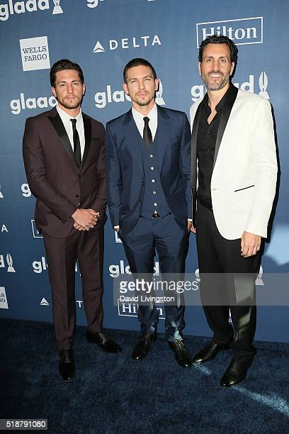 Actors Brent Antonello and Adam Senn and executive producer James LaRosa arrive at the 27th Annual GLAAD Media Awards at The Beverly Hilton Hotel on...
