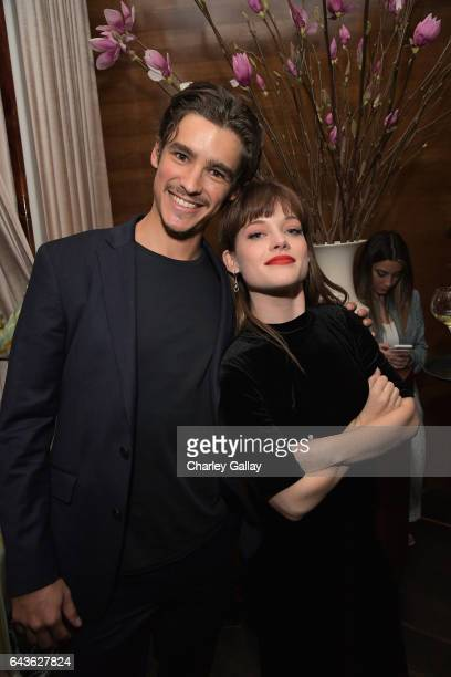 Actors Brenton Thwaites and Jane Levy attend Vanity Fair and L'Oreal Paris Toast to Young Hollywood hosted by Dakota Johnson and Krista Smith at...