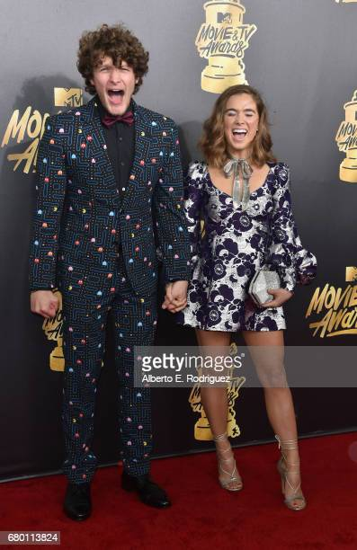 Actors Brett Dier and Haley Lu Richardson attend the 2017 MTV Movie And TV Awards at The Shrine Auditorium on May 7 2017 in Los Angeles California