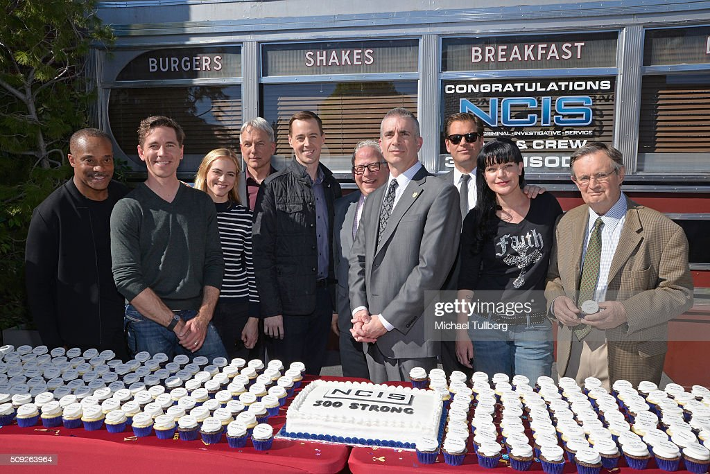 Actors Brian Dietzen, Rocky Carroll, <a gi-track='captionPersonalityLinkClicked' href=/galleries/search?phrase=Mark+Harmon&family=editorial&specificpeople=208897 ng-click='$event.stopPropagation()'>Mark Harmon</a>, Emily Wickersham and <a gi-track='captionPersonalityLinkClicked' href=/galleries/search?phrase=Sean+Murray+-+Actor&family=editorial&specificpeople=3214717 ng-click='$event.stopPropagation()'>Sean Murray</a>, executive producer Gary Glasberg, NCIS Director Andrew Traver and actors <a gi-track='captionPersonalityLinkClicked' href=/galleries/search?phrase=Michael+Weatherly&family=editorial&specificpeople=3321266 ng-click='$event.stopPropagation()'>Michael Weatherly</a>, <a gi-track='captionPersonalityLinkClicked' href=/galleries/search?phrase=Pauley+Perrette&family=editorial&specificpeople=625846 ng-click='$event.stopPropagation()'>Pauley Perrette</a> and <a gi-track='captionPersonalityLinkClicked' href=/galleries/search?phrase=David+McCallum&family=editorial&specificpeople=588632 ng-click='$event.stopPropagation()'>David McCallum</a> attend the cake cutting celebration for 'NCIS' 300th episode on February 9, 2016 in Valencia, California.