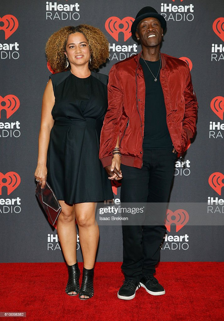 Actors Bridgid Coulter (L) and Don Cheadle attend the 2016 iHeartRadio Music Festival at T-Mobile Arena on September 23, 2016 in Las Vegas, Nevada.