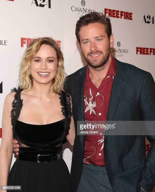 Actors Brie Larson and Armie Hammer attend the premiere of A24's 'Free Fire' at ArcLight Hollywood on April 13 2017 in Hollywood California