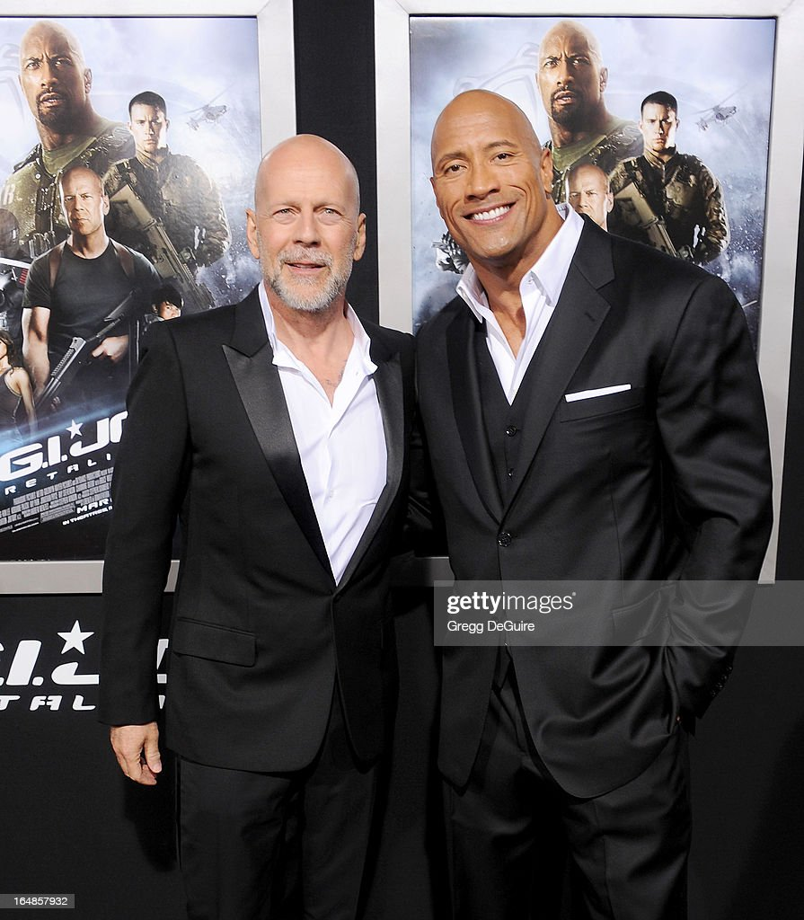 Actors <a gi-track='captionPersonalityLinkClicked' href=/galleries/search?phrase=Bruce+Willis&family=editorial&specificpeople=202185 ng-click='$event.stopPropagation()'>Bruce Willis</a> and <a gi-track='captionPersonalityLinkClicked' href=/galleries/search?phrase=Dwayne+Johnson&family=editorial&specificpeople=210704 ng-click='$event.stopPropagation()'>Dwayne Johnson</a> arrive at the 'G.I. Joe: Retaliation' Los Angeles premiere at TCL Chinese Theatre on March 28, 2013 in Hollywood, California.