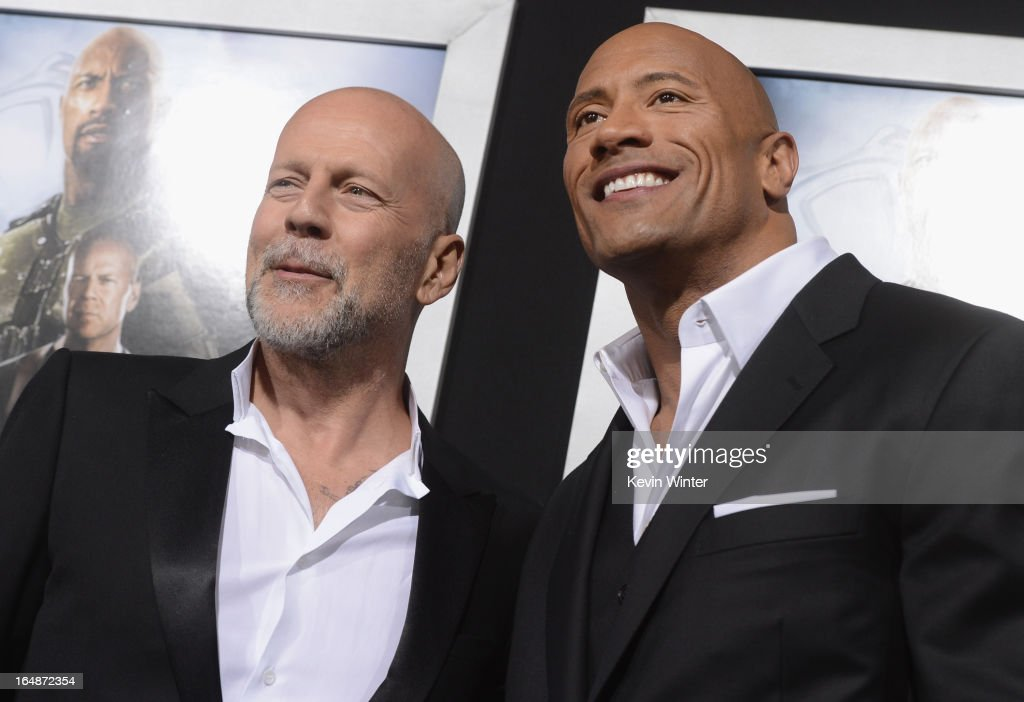Actors Bruce Willis and Dwayne Johnson attend the premiere of Paramount Pictures' 'G.I. Joe:Retaliation' at TCL Chinese Theatre on March 28, 2013 in Hollywood, California.
