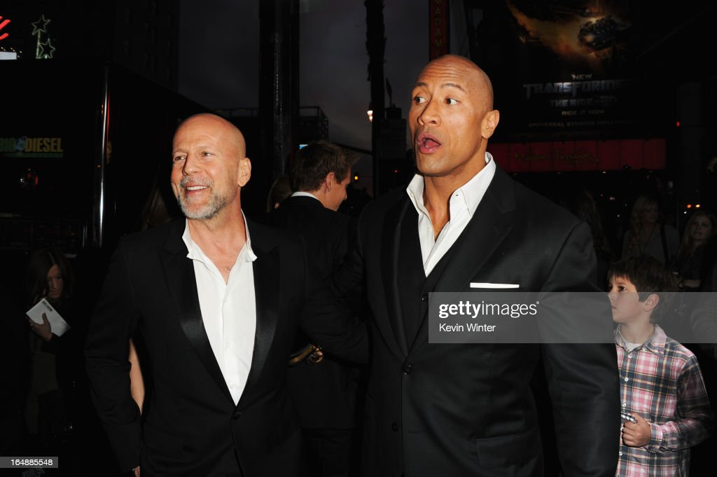 Actors Bruce Willis and Dwayne 'The Rock' Johnson attend the premiere of Paramount Pictures' 'G.I. Joe:Retaliation' at TCL Chinese Theatre on March 28, 2013 in Hollywood, California.