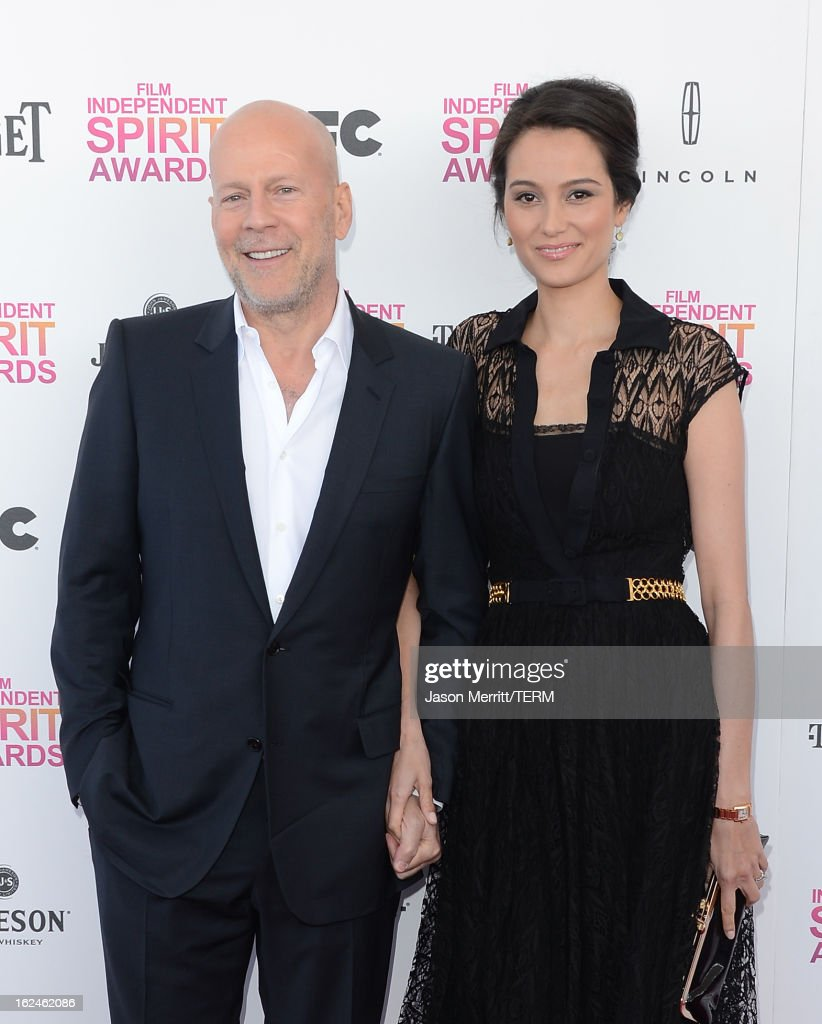 Actors <a gi-track='captionPersonalityLinkClicked' href=/galleries/search?phrase=Bruce+Willis&family=editorial&specificpeople=202185 ng-click='$event.stopPropagation()'>Bruce Willis</a> and <a gi-track='captionPersonalityLinkClicked' href=/galleries/search?phrase=Emma+Heming&family=editorial&specificpeople=734062 ng-click='$event.stopPropagation()'>Emma Heming</a> attend the 2013 Film Independent Spirit Awards at Santa Monica Beach on February 23, 2013 in Santa Monica, California.