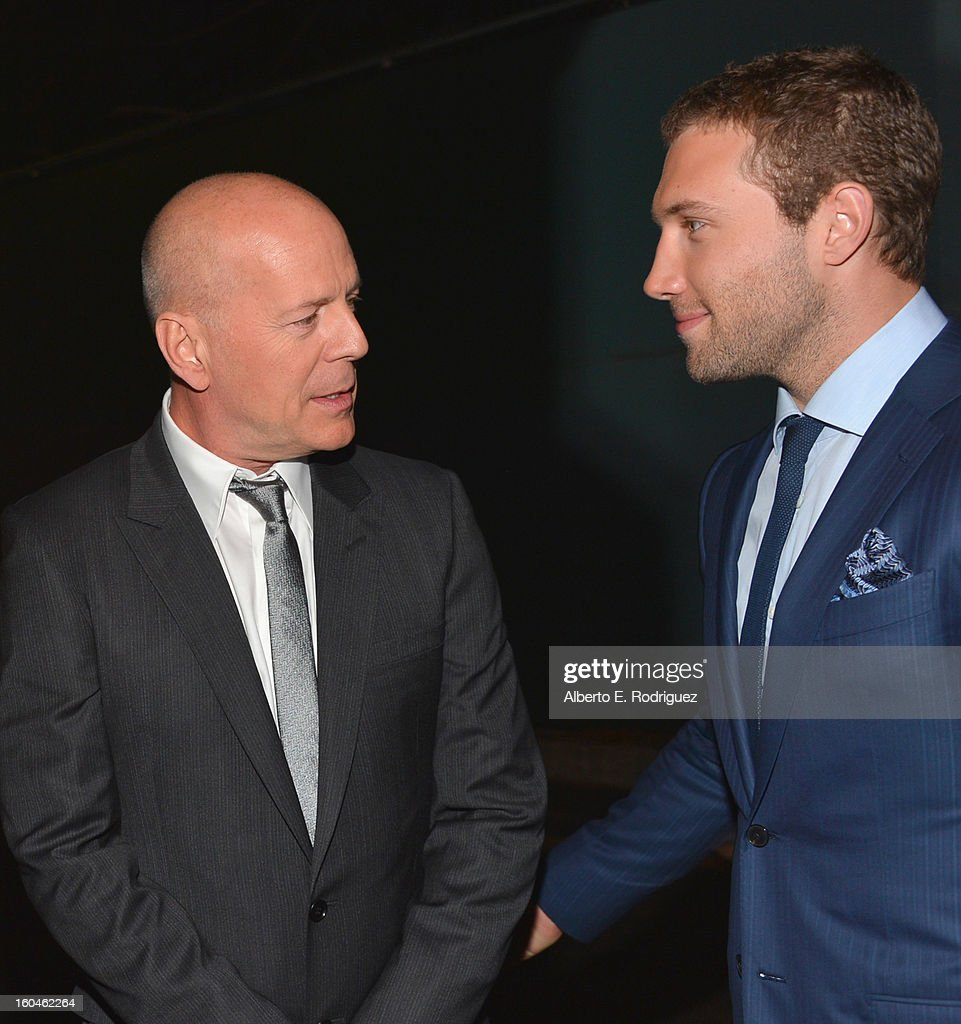 Actors Bruce Willis and Jai Courtney attend the dedication and unveiling of a new soundstage mural celebrating 25 years of 'Die Hard' at Fox Studio Lot on January 31, 2013 in Century City, California.