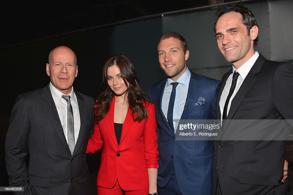 Actors Bruce Willis, Julia Snigir, Jai Courtney and Rasha Bukvic attend the dedication and unveiling of a new soundstage mural celebrating 25 years of 'Die Hard' at Fox Studio Lot on January 31, 2013 in Century City, California.