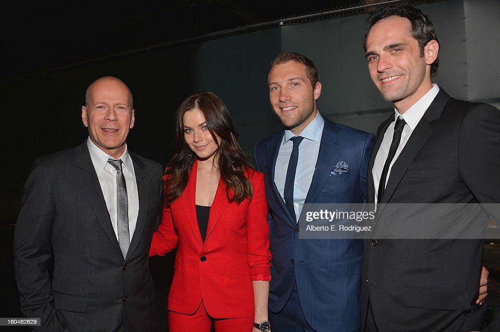 Actors <a gi-track='captionPersonalityLinkClicked' href=/galleries/search?phrase=Bruce+Willis&family=editorial&specificpeople=202185 ng-click='$event.stopPropagation()'>Bruce Willis</a>, Julia Snigir, Jai Courtney and Rasha Bukvic attend the dedication and unveiling of a new soundstage mural celebrating 25 years of 'Die Hard' at Fox Studio Lot on January 31, 2013 in Century City, California.