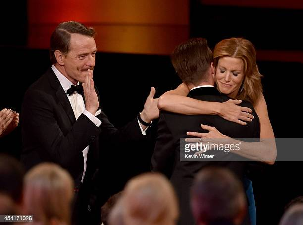 Actors Bryan Cranston Aaron Paul and Anna Gunn celebrate winning Outstanding Drama Series for 'Breaking Bad' onstage at the 66th Annual Primetime...