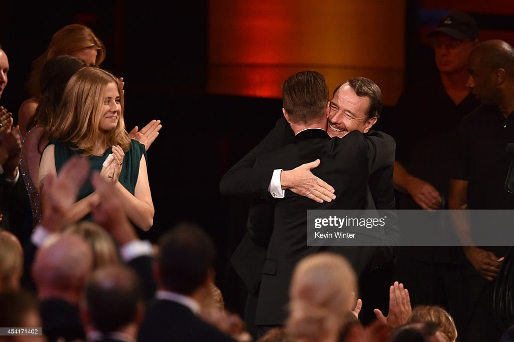 Actors <a gi-track='captionPersonalityLinkClicked' href=/galleries/search?phrase=Bryan+Cranston&family=editorial&specificpeople=217768 ng-click='$event.stopPropagation()'>Bryan Cranston</a> (R) and <a gi-track='captionPersonalityLinkClicked' href=/galleries/search?phrase=Aaron+Paul+-+Actor&family=editorial&specificpeople=693211 ng-click='$event.stopPropagation()'>Aaron Paul</a> celebrate winning Outstanding Drama Series for 'Breaking Bad' onstage at the 66th Annual Primetime Emmy Awards held at Nokia Theatre L.A. Live on August 25, 2014 in Los Angeles, California.