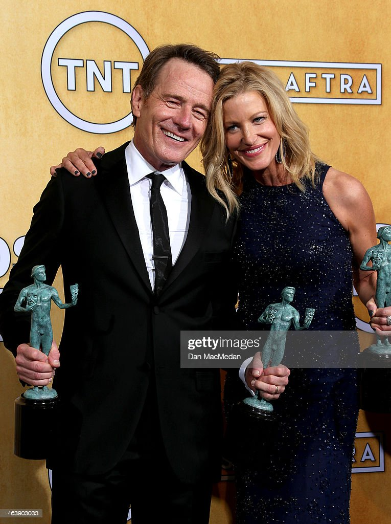 Actors <a gi-track='captionPersonalityLinkClicked' href=/galleries/search?phrase=Bryan+Cranston&family=editorial&specificpeople=217768 ng-click='$event.stopPropagation()'>Bryan Cranston</a> and <a gi-track='captionPersonalityLinkClicked' href=/galleries/search?phrase=Anna+Gunn&family=editorial&specificpeople=589359 ng-click='$event.stopPropagation()'>Anna Gunn</a> pose in the press room with the award for Outstanding Performance by an Ensemble in a Drama Series for 'Breaking Bad' at the 20th Annual Screen Actors Guild Awards at the Shrine Auditorium on January 18, 2014 in Los Angeles, California.
