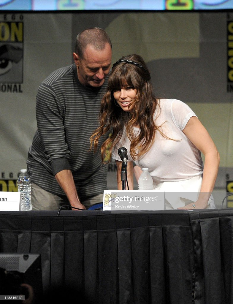 Actors Bryan Cranston (L) and Jessica Biel speak during Sony's 'Total Recall' panel during Comic-Con International 2012 at San Diego Convention Center on July 13, 2012 in San Diego, California.