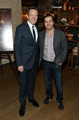 Actors Bryan Cranston and John Leguizamo attend a celebration for Bryan Cranston at House of Elyx on December 13 2015 in New York City