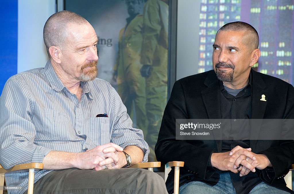 Actors Bryan Cranston and Steven Michael Quezada converse following a tribute during the ABQ Studios And Youth Development Inc. Honor The Cast Of 'Breaking Bad' on at Albuquerque Studios on March 16, 2013 in Albuquerque, New Mexico.