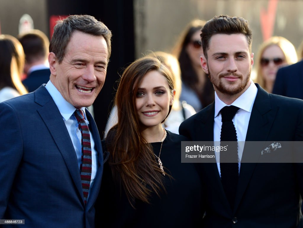 Actors <a gi-track='captionPersonalityLinkClicked' href=/galleries/search?phrase=Bryan+Cranston&family=editorial&specificpeople=217768 ng-click='$event.stopPropagation()'>Bryan Cranston</a>, <a gi-track='captionPersonalityLinkClicked' href=/galleries/search?phrase=Elizabeth+Olsen&family=editorial&specificpeople=5775031 ng-click='$event.stopPropagation()'>Elizabeth Olsen</a> and Aaron Taylor-Johnson attend the premiere of Warner Bros. Pictures and Legendary Pictures' 'Godzilla' at Dolby Theatre on May 8, 2014 in Hollywood, California.