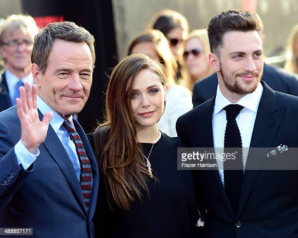 Actors Bryan Cranston Elizabeth Olsen and Aaron TaylorJohnson attend the premiere of Warner Bros Pictures and Legendary Pictures' 'Godzilla' at Dolby...