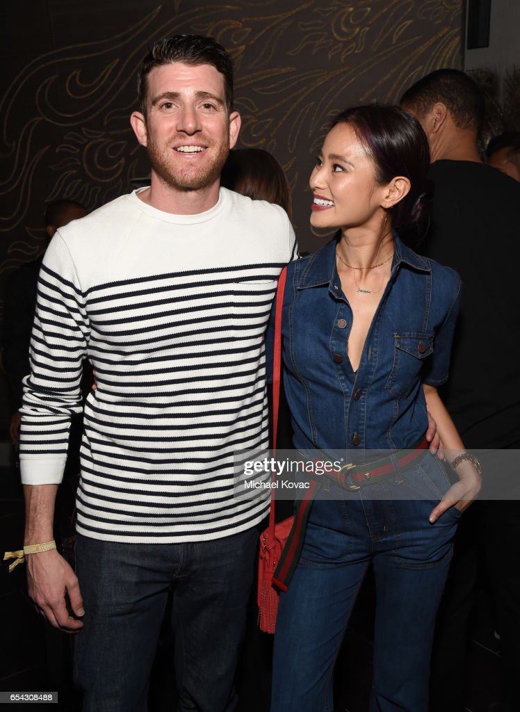 Actors Bryan Greenberg (L) and Jamie Chung attend day one of TAO, Beauty + Essex, Avenue + Luchini LA Grand Opening on March 16, 2017 in Los Angeles, California.