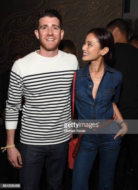 Actors Bryan Greenberg and Jamie Chung attend day one of TAO Beauty Essex Avenue Luchini LA Grand Opening on March 16 2017 in Los Angeles California