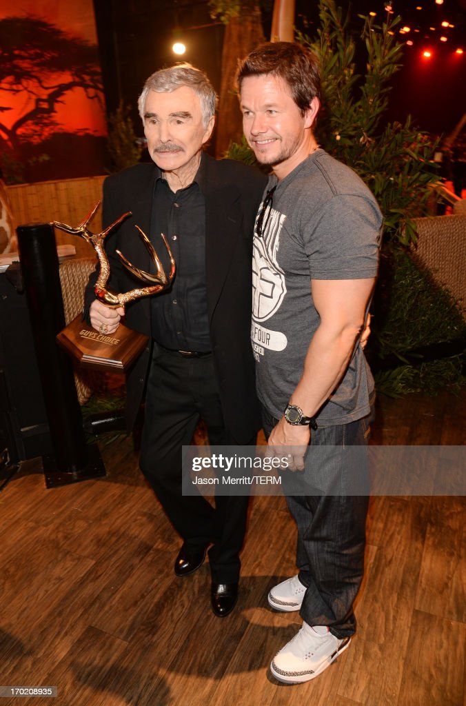 Actors <a gi-track='captionPersonalityLinkClicked' href=/galleries/search?phrase=Burt+Reynolds&family=editorial&specificpeople=204674 ng-click='$event.stopPropagation()'>Burt Reynolds</a> (L) and <a gi-track='captionPersonalityLinkClicked' href=/galleries/search?phrase=Mark+Wahlberg&family=editorial&specificpeople=202265 ng-click='$event.stopPropagation()'>Mark Wahlberg</a> attend Spike TV's Guys Choice 2013 at Sony Pictures Studios on June 8, 2013 in Culver City, California.