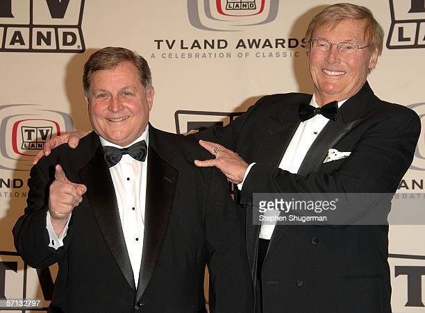 Actors Burt Ward and Adam West of 'Batman' pose in the press room at the 2006 TV Land Awards at the Barker Hangar on March 19 2006 in Santa Monica...