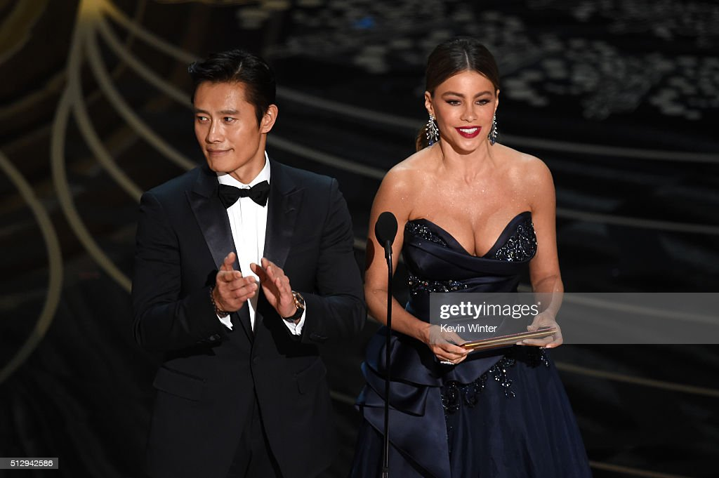 Actors Byung-hun Lee (L) and Sofia Vergara speak onstage during the 88th Annual Academy Awards at the Dolby Theatre on February 28, 2016 in Hollywood, California.